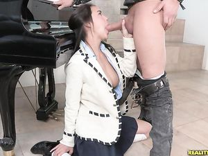 Big Breasted Cocksucker On Her Knees Eating Meat