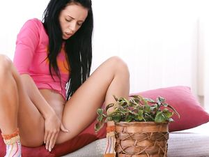 Pissing Girl Soaks The Floor And A Green Plant