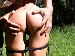 Guys Share A Cute Amateur Chick In A Grassy Field