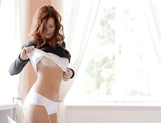 Redhead Stunning Angel Stripping Slowly And Sensually